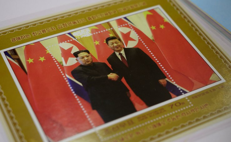 <span>A commemorative stamp featuring North Korean leader Kim Jong-Un (L) meeting with China's leader Xi Jinping is pictured at a shop in Pyongyang on June 18, 2019. - Xi Jinping will make the first trip to North Korea by a Chinese president in 14 years this week, state media said on June 18, as Beijing tightens relations with Pyongyang amid tensions with the United States. AFP</span><br /><br />