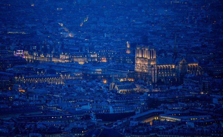 This file general view taken on January 8, 2018 from the rooftop of The Tour Montparnasse at twilight shows The Notre-Dame de Paris Cathedral in Paris. AFP