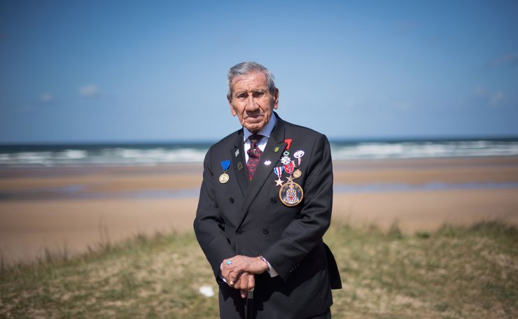 In this file photo taken on May 4, 2019, World War II veteran Charles Norman Shay, a Penobscot Native American, who took part in the Operation Overlord (Battle of Normandy) during D-Day on June 6, 1944, poses on May 4, 2019 in in Omaha Beach, western France. - Seventy-five years ago on a beach in northern France, Charles Norman Shay was a Native American far from home. It was June 6, 1944, and the 19-year-old military nurse was on Omaha beach, the bloodiest of the five sites picked for the D-Day landings. Nearly 500 Native Americans fought alongside Allied soldiers to dislodge German forces from the French coast, marking the start of France's liberation from its Nazi occupiers. AFP