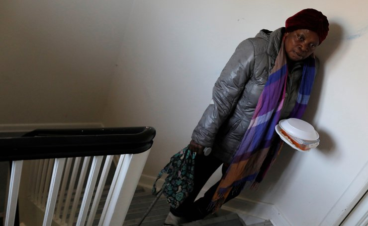 Vero Seryi, 45 from Nigeria, returns to her room in the women's block with her meal, one of three a day provided by the centre at Kaershovedgaard, a former prison and now a departure center for rejected asylum seekers in Jutland, Denmark, March 25, 2019. Reuters