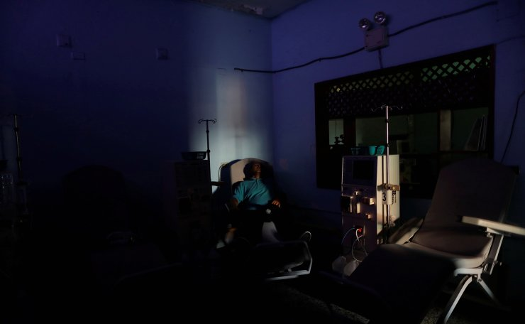 William Lopez, 45, a patient with kidney disease, waits for the electricity to return, at a dialysis centre, during a blackout in Maracaibo, Venezuela, April 11, 2019. 'The impotence that I feel makes me want to cry,' said Lopez 'Some people go to sleep while they are in treatment. I do not, because I am scared I will never wake up. Reuters