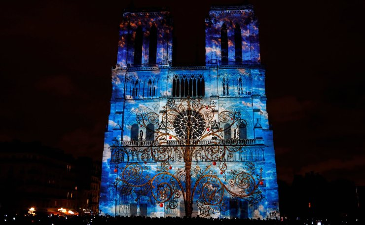 This file photo taken on November 11, 2017 shows the Notre-Dame de Paris Cathedral being illuminated during a light show as part of the Armistice Day commemorations marking the end of WWI (World War One). AFP