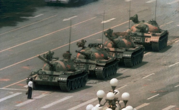 FILE - In this June 5, 1989 file photo, a Chinese man stands alone to block a line of tanks heading east on Beijing's Changan Blvd. in Tiananmen Square. The man, calling for an end to the recent violence and bloodshed against pro-democracy demonstrators, was pulled away by bystanders, and the tanks continued on their way. Over seven weeks in 1989, student-led pro-democracy protests centered on Beijing's Tiananmen Square became China's greatest political upheaval since the end of the Cultural Revolution more than a decade earlier. AP