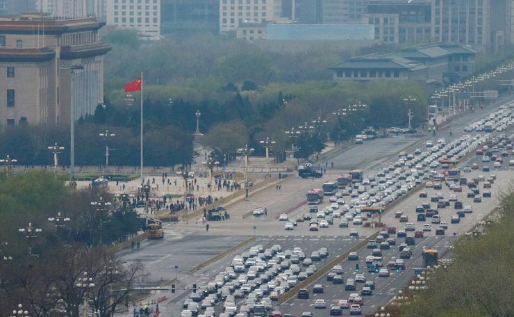 <span>Cars line Chang'an Avenue at Tiananmen Square in Beijing, China April 9, 2019. Reuters</span><br /><br />