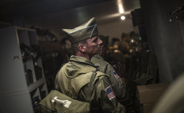 Enthusiasts from France and Netherlands visit a supply souvenir shop as they take part of a camp re-enactment of the 4th Infantry Division of the US Army next to Utah Beach in Sainte-Marie du Mont, Normandy, France, Sunday, June 2, 2019. AP