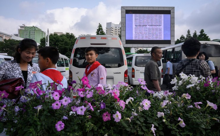 A public television screen shows an op-ed text by China's leader Xi Jinping published by North Korea's Rodong Sinmun newspaper, in a public square in Pyongyang on June 19, 2019. AFP