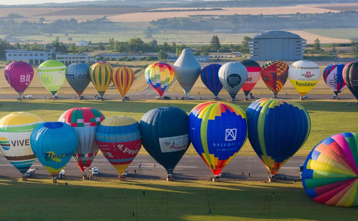 An aerial picture taken on July 29, 2019 shows more than 400 hot air-balloons at the Chambley-Bussieres airbase in eastern France, before an attempt to break the simultaneous air-balloon take off world record, as part of the international air-balloon meeting 'Grand-Est Mondial Air Ballons' (Gemab). AFP