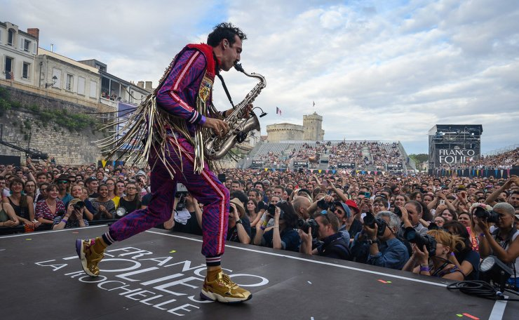 French musician Pepe of the music group Deluxe performs on stage during the 35th edition of the Francofolies Music Festival, in La Rochelle, southwestern France, on July 11, 2019. AFP