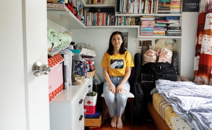 <span>Native Hong Kong resident Ruby Leung, 22, a law student, who lives with her mother and domestic helper, poses for a picture in her 7 sq meter bedroom of her family's apartment in Hong Kong, China, June 29, 2019. They promised to have a one country, two systems for 50 years, so people panic about what will happen in 50 years. Will they continue this, or will they just assimilate us into part of China, like a district in Shenzhen? That's very scary,' Leung said. 'There was a hope that we could get universal suffrage. But then the situation got worse. Not only do we not have universal suffrage, but the Chinese government is even more influential in politics.' Reuters</span><br /><br />