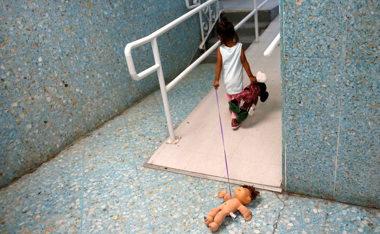 A Central American child plays on a hallway of the Catholic shelter 'San Francisco Javier Church', which gives temporary shelter to asylum-seekers from Central America countries released by ICE and U.S. Customs and Border Protection (CBP) due to overcrowded facilities, in Laredo, Texas U.S. June 4, 2019. Picture taken on June 4, 2019. Reuters