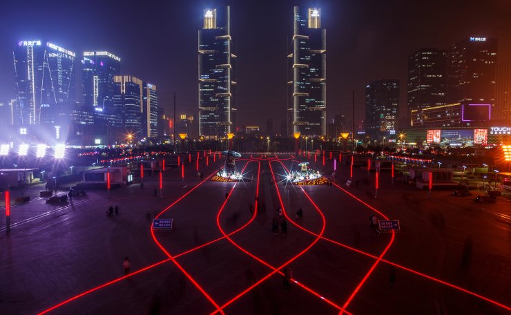 <span>LED lights in the pavement illuminate the square in front of a high speed rail way station in the new business district of Zhengzhou, Henan province China, February 22, 2019. Reuters</span><br /><br />