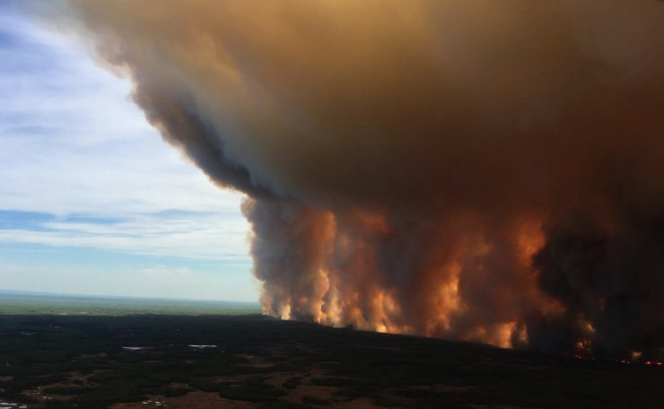The Chuckegg Creek wildfire burns out of control in the High Level Forest Area, to the southwest and west of the town of High Level, Alberta, Canada in this May 19, 2019 picture obtained from social media. Reuters
