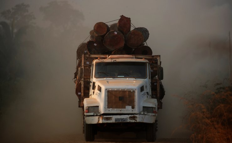 A truck loaded with logs cut from an area of the Amazon rainforest is seen near Humaita, Amazonas State, Brazil August 14, 2019. Picture Taken August 14, 2019. Reuters