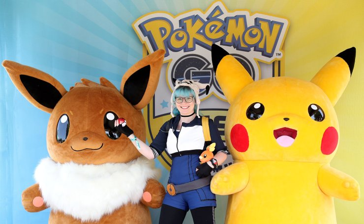 A girl poses with Pokemon figures Pikachu (R) and Eevee (L) during the 'Pokemon Go Fest' event in Dortmund, Germany, 04 July 2019. More than 150,000 fans of the smartphone game 'Pokemon Go' are expected in Dortmund from 04 to 07 July 2019. The 'Pokemon Go' festival held for the first time in Europe and is only available in this form in Chicago and Yokohama. EPA