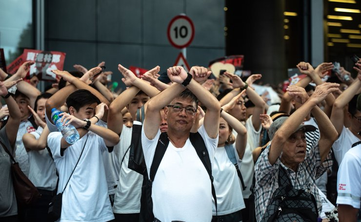 Protesters gesture as they chant 'no extradition' as they rally against a controversial extradition law proposal in Hong Kong on June 9, 2019. AFP