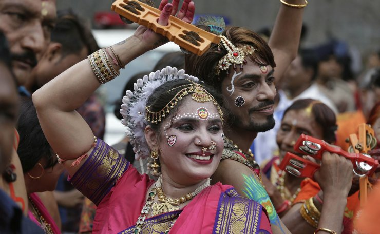Indian Hindu devotees participate in the annual festival of Rath Yatra, or chariot procession, in Ahmadabad, India, Thursday, July 4, 2019. Three idols of Hindu deities Jagannath, Balabhadra and Subhadra are taken out in a grand procession in specially made chariots called raths, which are pulled by thousands of devotees on this day. AP