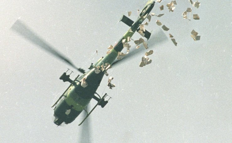A military helicopter drops leaflets above Tiananmen Square in Beijing, China, May 22, 1989, which state that the student protesters should leave the Square as soon as possible on Monday morning. Reuters