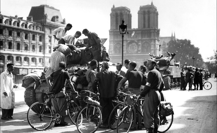 This file photo taken on August 25, 1944 shows people gathering around a tank from French General Leclerc's 2nd Armored Division near Notre-Dame in Paris. AFP
