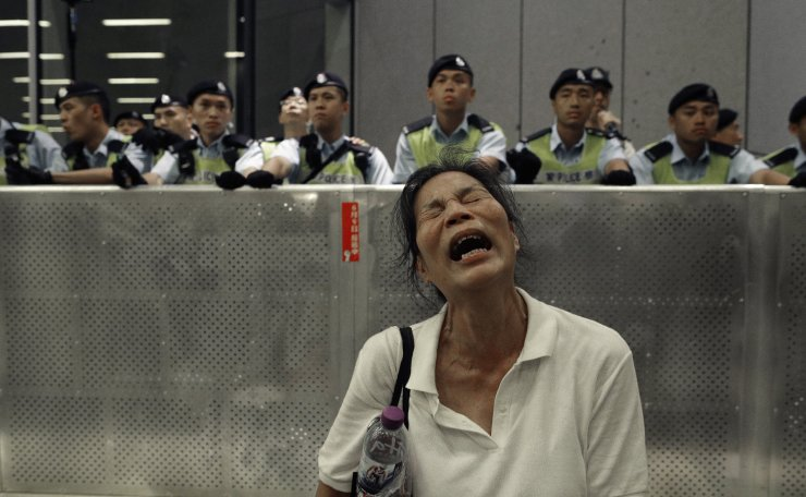 A protester reacts as police officers clash with protesters in a rally against the proposed amendments to the extradition law at the Legislative Council in Hong Kong during the early hours of Monday, June 10, 2019. AP