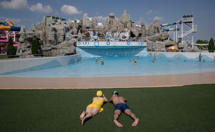 <span>In a photo taken on June 16, 2019 swimmers rest beside a wave pool at the Munsu water park in Pyongyang. AFP</span><br /><br />
