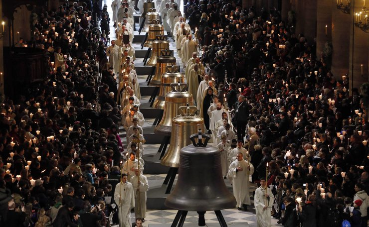 In this file photo taken on February 2, 2013 people attend a ceremony to inaugurate nine new church bells at Notre-Dame de Paris Cathedral. AFP