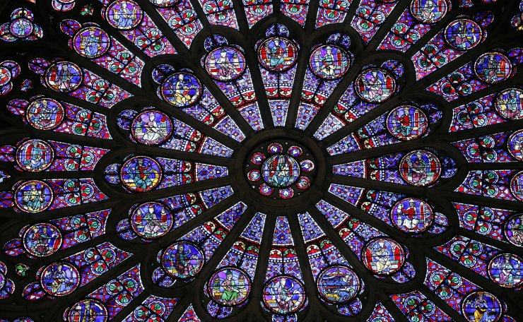 This file photo taken on November 29, 2012 shows the middle-age stained glass rosace on the northern side of the Notre-Dame de Paris cathedral. - Paris was struck in its very heart as flames devoured the roof of Notre-Dame cathedral, causing a spire to collapse and raising fears over the future of the nearly millenium old building and its precious artworks. Around 400 firefighters battled through the night, declaring only at around 10 am on April 16 that the fire had finally been extinguished but French Culture minister warned that the structure remained unstable and that no one had yet been able to fully inspect the extent of the fire and water damage inside. AFP