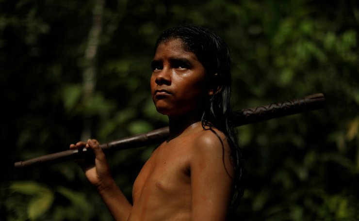 An indigenous named Pedro Mura from the Mura tribe reacts in front a deforested area in ??nondemarcated indigenous land inside the Amazon rainforest near Humaita, Amazonas State, Brazil August 20, 2019. Picture taken August 20, 2019. Reuters