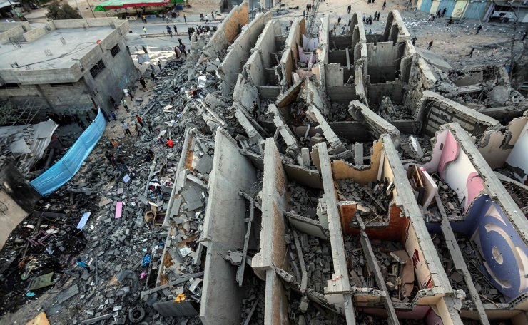 A picture taken on May 5, 2019, shows the remains of a building in Gaza City after it was hit during Israeli air strikes. - Israel's military carried out waves of retaliatory strikes in the Gaza Strip today after Palestinian rockets hit Israeli cities as a deadly escalation showed no signs of slowing, raising fears of war. AFP