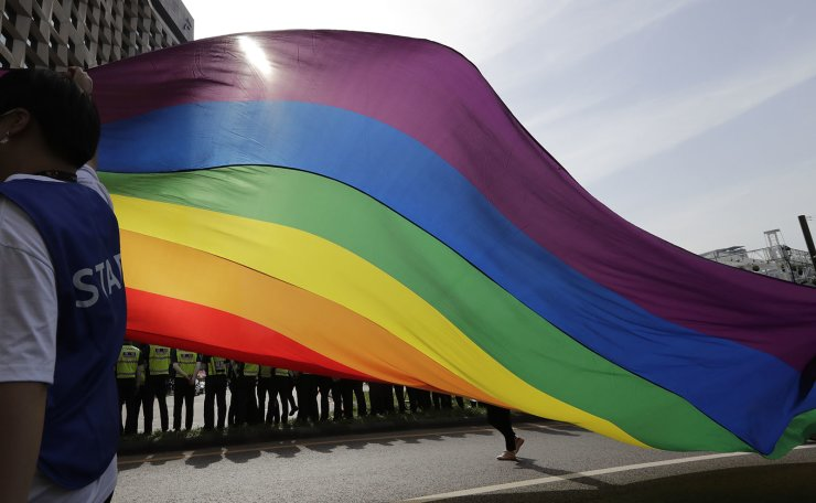 A huge rainbow flag is carried during a parade as a part of the Seoul Queer Culture Festival in Seoul, South Korea, Saturday, June 1, 2019. Tens of thousands of supporters and visitors participate in the 20th Seoul Queer Culture Festival which is held from May 21 until June 9. AP