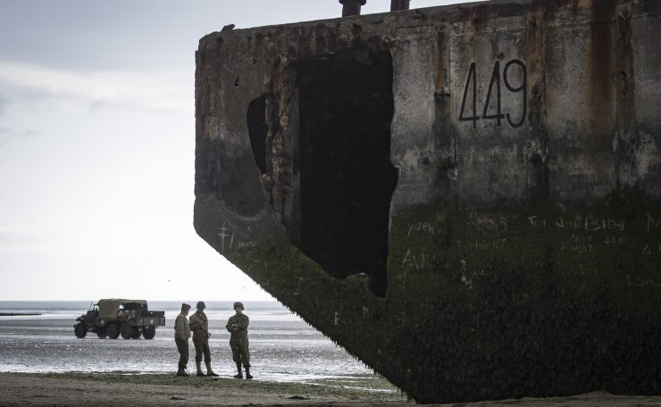 History enthusiasts in uniform tour the beach near the ruins of a military pontoon on the Normandy coast ahead of the 75th D-Day anniversary, in Arromanches, France, 04 June 2019. EPA