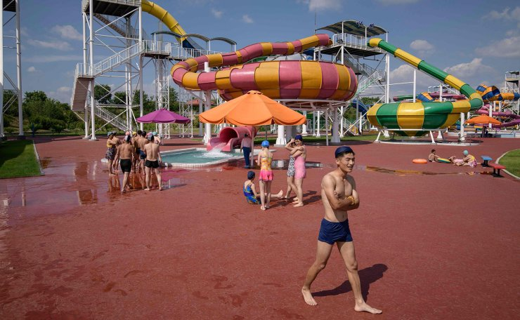 <span>In a photo taken on June 16, 2019 swimmers make their way between water slides at the Munsu water park in Pyongyang. AFP</span><br /><br />