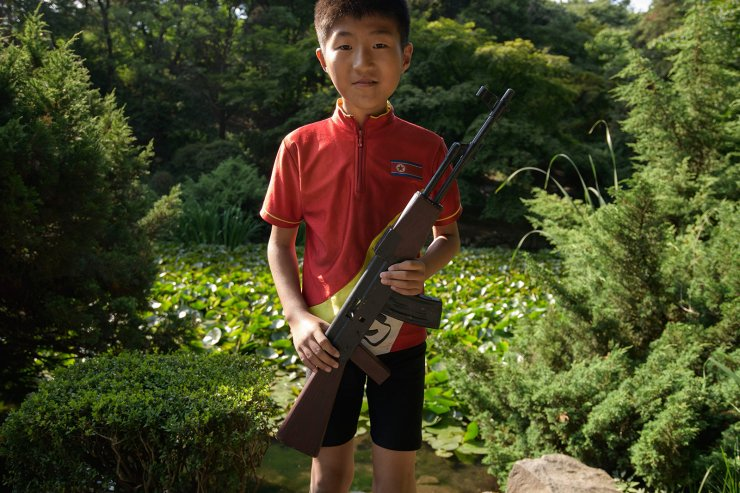 <span>In a photo taken on June 16, 2019 a child poses with a mock assault rifle at the Moran hill park in Pyongyang. AFP</span><br /><br />