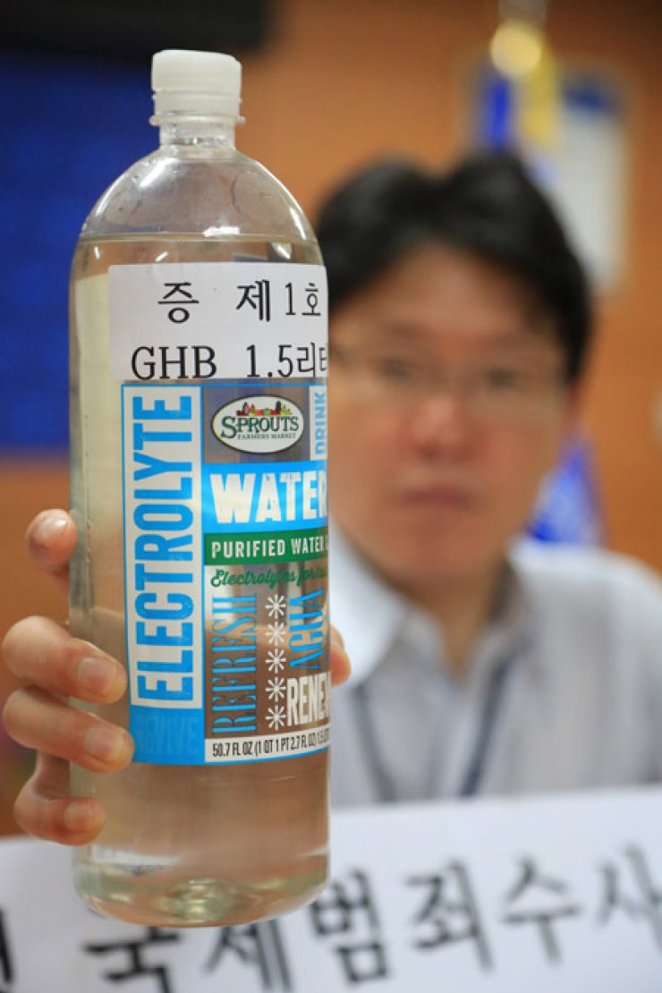 A 1.5-liter bottle of gamma hydroxybutyrate (GHB) confiscated from him. / Yonhap