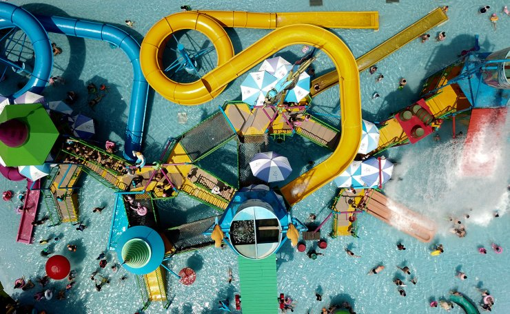 Aerial photo taken on July 28, 2019 shows people enjoying themselves at a water park in Hefei, capital of east China's Anhui Province. People chose to take part in activities on water to cool off themselves during hot weather here. Xinhua
