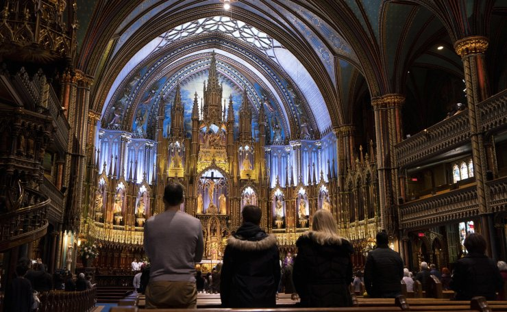 A mass is celebrated in solidarity with the Archdiocese of Paris, following yesterday's fire at Notre-Dame Cathedral in Paris, at the Notre-Dame Basilica in Montreal on Tuesday, April 16, 2019. The Montreal basilica is inspired by the famed Paris cathedral. AP