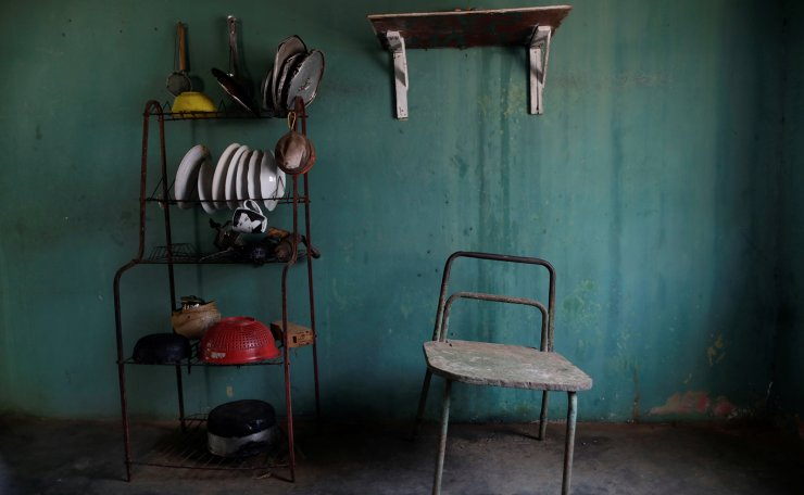 A chair stands next to kitchen equipment in the house of Aidalis Guanipa, 25, a kidney disease patient, during a blackout in La Concepcion, Venezuela, April 12, 2019. Reuters