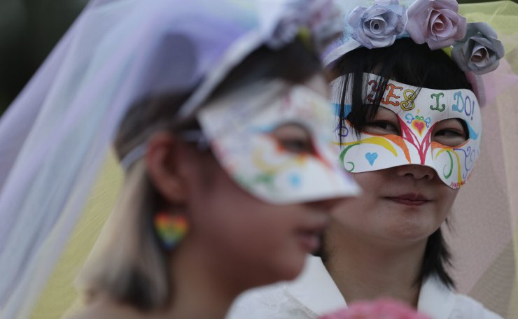 A Lesbian couple arrive to attend a Mass wedding ceremony for Same-sex marriage in Taipei, Taiwan, 25 May 2019. Taiwan became the first Asian country to legalize same-sex marriage on 24 May 2019. EPA