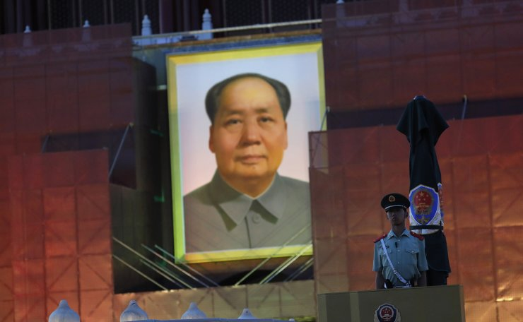 <span>A Chinese paramilitary police officer stand guard in front of a portrait of former leader Mao Zedong at Tiananmen Square in Beijing, China, 30 May 2019. EPA</span><br /><br />