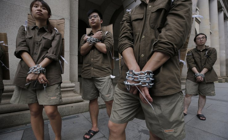Students in chains march to protest against the extradition bill in Hong Kong, Saturday, June 8, 2019. AP