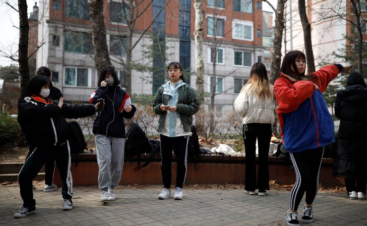 Nao Niitsu, 19, college freshman from Tokyo, who wants to be a K-pop star, and other Japanese children warm up for an audition at a park in Seoul, South Korea, March 15, 2019. Reuters