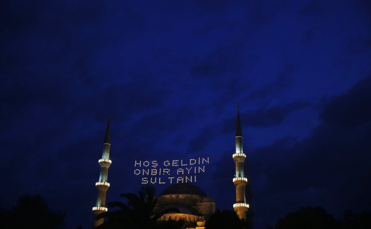 Lights reading in Turkish: 'Welcome, the Sultan of 11 months', decorate the minarets of the iconic Sultan Ahmed Mosque, better known as the Blue Mosque, in the historic Sultanahmet district of Istanbul, Monday, May 6, 2019, on the first day of the fasting month of Ramadan. AP