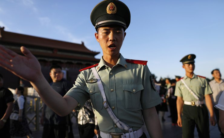 <span>Chinese paramilitary police officers usher visitors away for the daily flag lowering ceremony at Tiananmen Square in Beijing, China, 30 May 2019. EPA</span><br /><br />