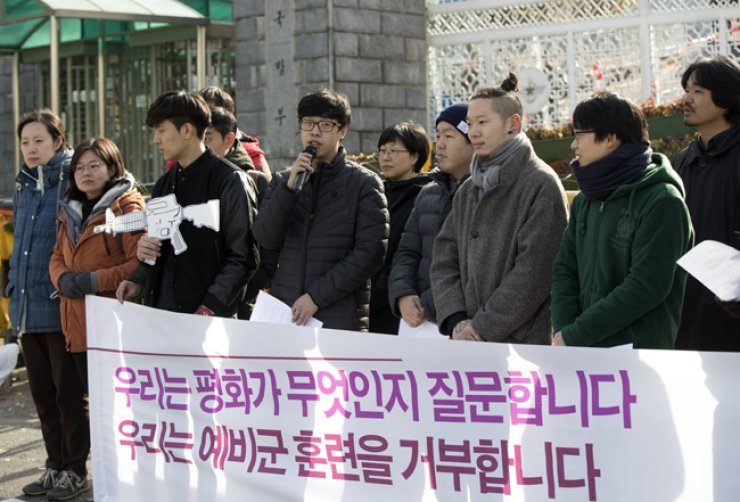 Those who refuse reserve forces training call for the nation to recognize conscientious objection and alternative service, at a press conference in front of the Ministry of National Defense in Seoul, Wednesday. / Yonhap