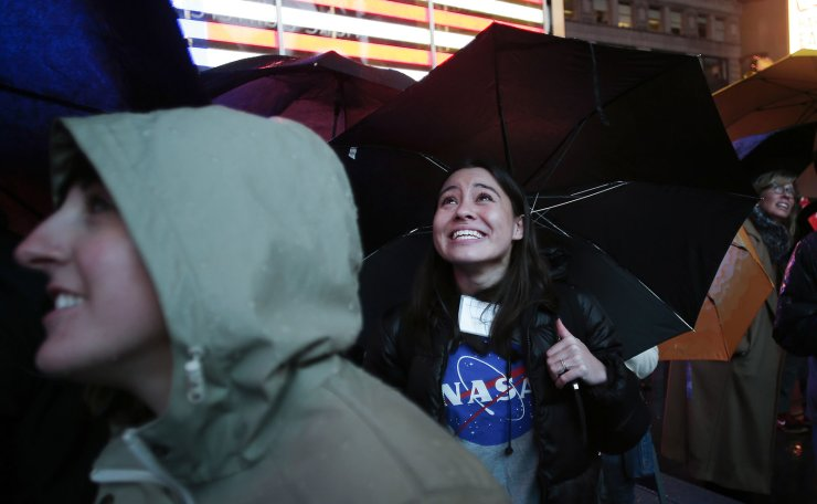 Revelers listen and watch as NASA's InSight spacecraft lands on Mars outside of the Nasdaq Marketplace in Times Square in New York City on November 26, 2018. UPI