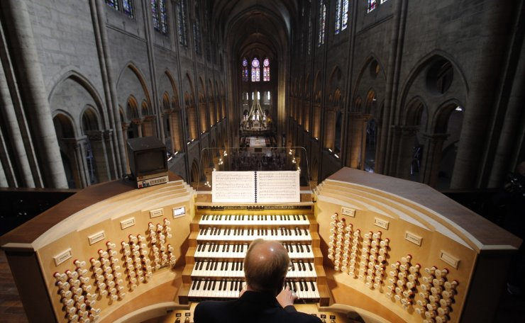 In this Thursday, May 2, 2013 file photo, Philippe Lefebvre, 64, plays the organ at Notre Dame cathedral in Paris. AP