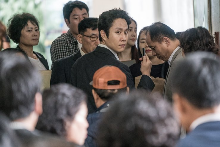 Jung Woo, center, in a scene from 'New Trial.' / Courtesy of OPUS Picture