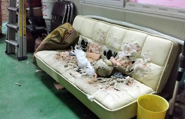 The couch that was torched by the fire. / Yonhap