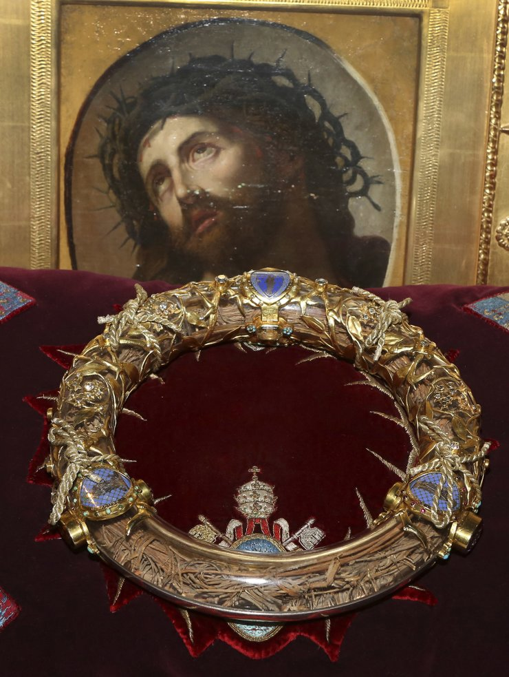 In this Friday March 21, 2014 file photo a crown of thorns which was believed to have been worn by Jesus Christ and which was bought by King Louis IX in 1239 is presented at Notre Dame Cathedral in Paris. Paris' mayor, Anne Hidalgo, said a significant collection of art and holy objects inside the church had been recovered from the fire at Notre Dame cathedral. AP
