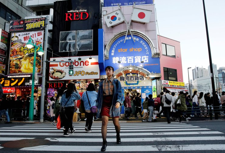 Nao Niitsu, 19, a college freshman from Tokyo, who wants to be a K-pop star, walks through Shin-Okubo district, which is known as Tokyo's Korea Town, in Tokyo, Japan, March 21, 2019. Reuters