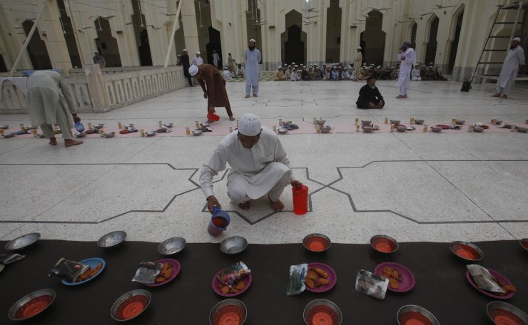 Pakistani volunteers arrange food or 'Iftari', for people fast during the month of Ramadan at a mosque in Peshawar, Pakistan, Monday, May 6, 2019. AP